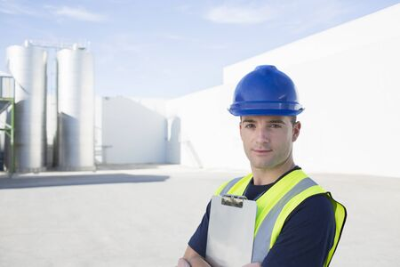 Portrait of confident worker with clipboard at granary