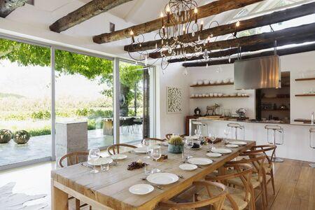 open floor plan: Chandelier over dining table in modern house