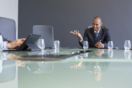 brazilian ethnicity: Businessman talking in meeting