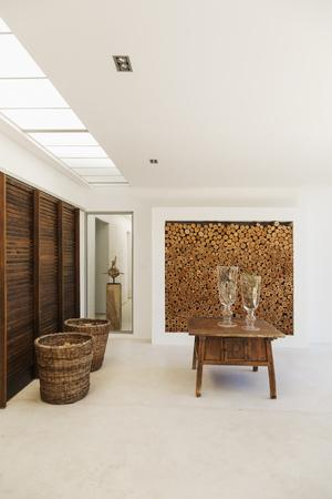 log basket: Wood accents in luxury foyer