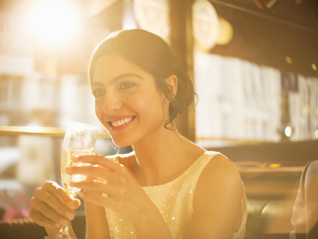 smile close up: Well-dressed woman drinking champagne in restaurant