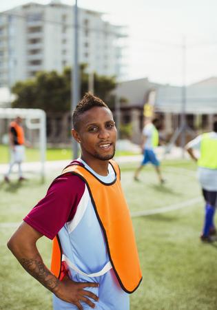 Soccer player smiling on field LANG_EVOIMAGES