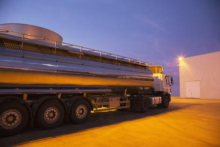 steel. milk: Stainless steel milk tanker parked at night