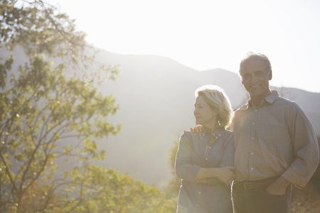 looking away from camera: Portrait of happy senior couple outdoors