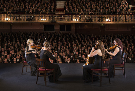 cellos: Quartet performing on stage in theater