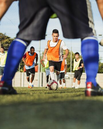 level playing field: Soccer players training on field LANG_EVOIMAGES