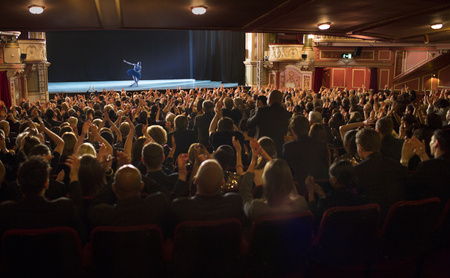 bowing head: Audience applauding ballerina on stage in theater LANG_EVOIMAGES