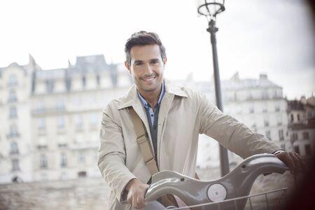 Businessman on bicycle, Paris, France