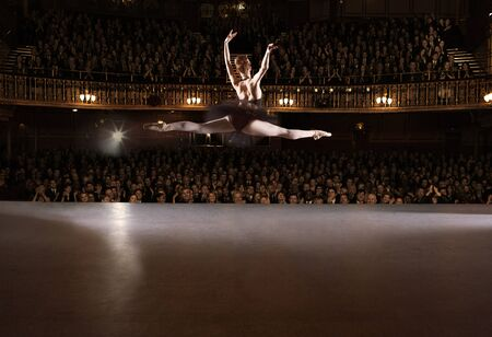 Ballet dancer performing on theater stage LANG_EVOIMAGES