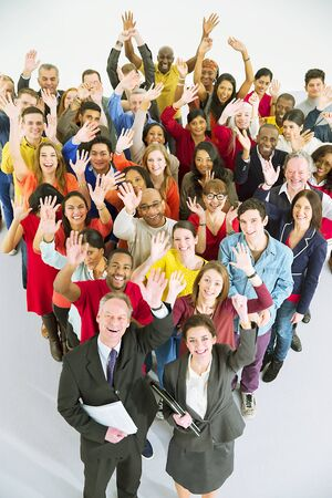Portrait of diverse workers waving