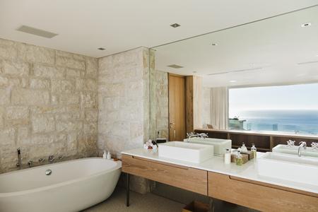 bathroom mirror: Modern bathroom with ocean view