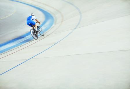 velodrome: Track cyclist riding around velodrome