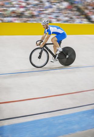 velodrome: Track cyclist riding in velodrome