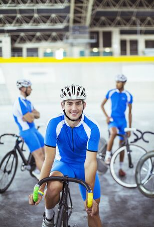 Portrait of track cyclist in velodrome LANG_EVOIMAGES