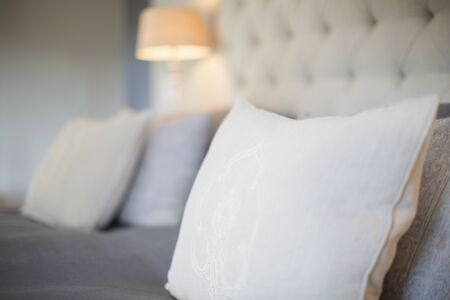 hotel bedroom: Pillows on bed in luxury bedroom LANG_EVOIMAGES