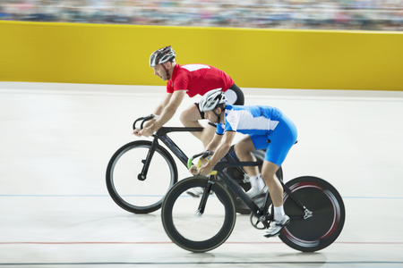 velodrome: Track cyclists racing in velodrome LANG_EVOIMAGES