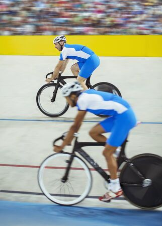 velodrome: Track cyclists riding in velodrome LANG_EVOIMAGES