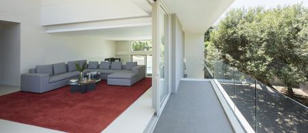 sectional door: Modern living room open to balcony LANG_EVOIMAGES