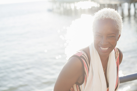 smile close up: Portrait of smiling woman at oceanfront