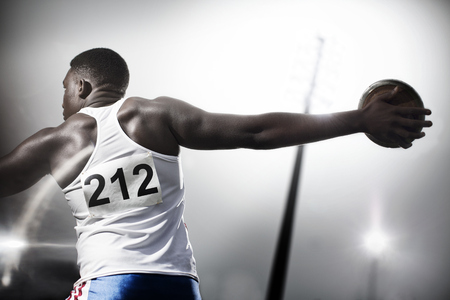 discus: Track and field athlete throwing discus