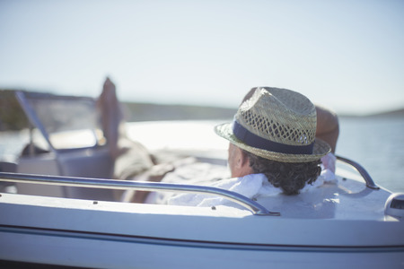 Older man relaxing in boat on water