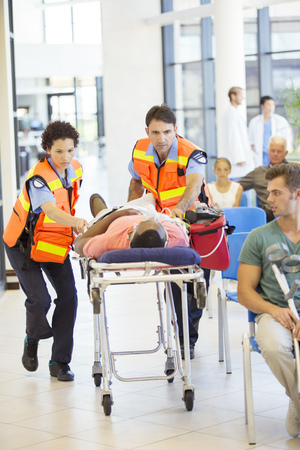 first day: Paramedics wheeling patient in hospital