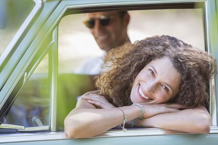Woman relaxing on car door during car ride