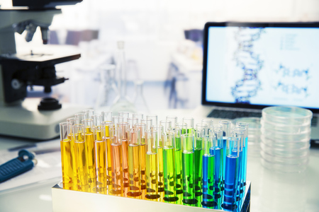 sample tray: Rack of test tubes with solution on counter in lab LANG_EVOIMAGES
