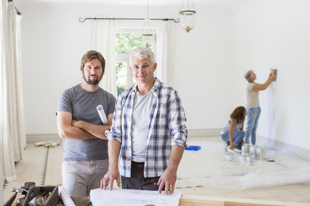 living room design: Father and son looking through construction plans