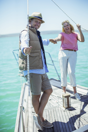 looking away from camera: Couple holding hands on boat LANG_EVOIMAGES