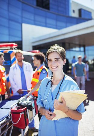 Nurse smiling outside hospital