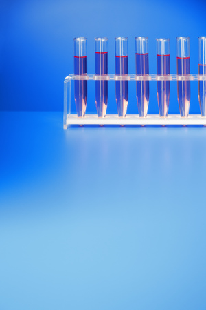sample tray: Rack of test tubes with solution on blue counter LANG_EVOIMAGES