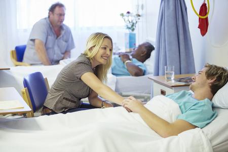 Woman talking to boyfriend in hospital
