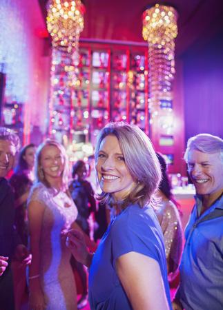 Happy mature people having fun in nightclub LANG_EVOIMAGES