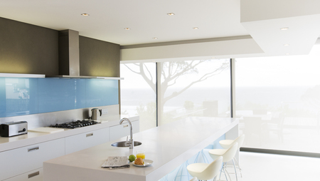 stool: Modern white kitchen with kitchen island and stools