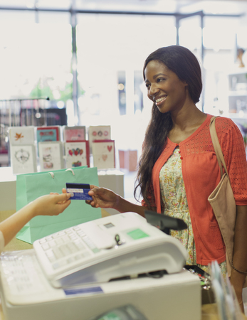 personal shopper: Woman paying with credit card in drugstore