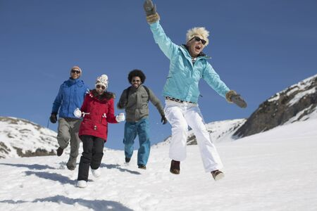 filipino people: Friends playing in snow LANG_EVOIMAGES