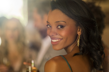 Portrait of young smiling woman at wedding reception