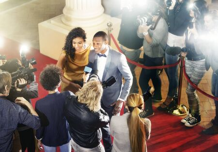 interviewed: Celebrity couple being interviewed on red carpet LANG_EVOIMAGES