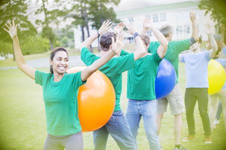coordinacion: Teammates performing fitness ball team building activity