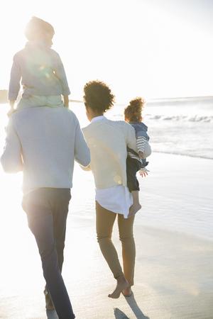 jamaican man: Happy family having fun on beach