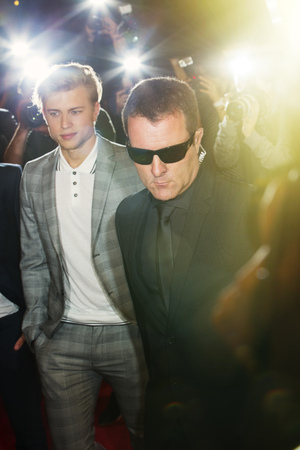 escorting: Bodyguard escorting celebrity at event LANG_EVOIMAGES