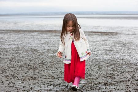 Girl in dress walking on beach