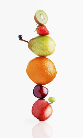 Stacked fruit on white background