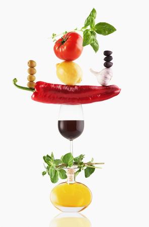 Fruit, vegetables, olive oil and wine balancing LANG_EVOIMAGES
