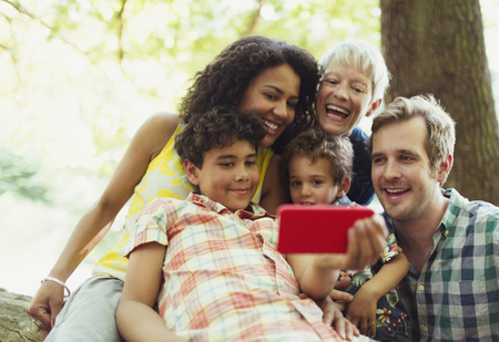 family: Multi-generation family taking selfie with camera phone in woods