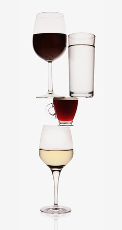 Wine, water and espresso glasses balancing