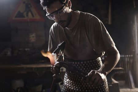 blowtorch: Blacksmith using blowtorch in forge LANG_EVOIMAGES