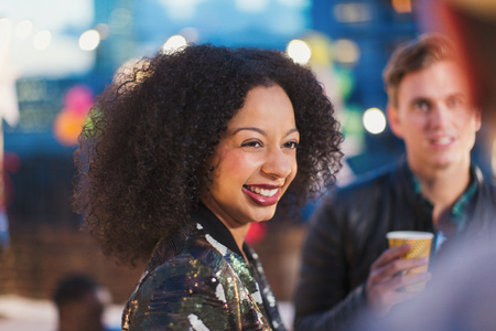jamaican man: Smiling woman enjoying party