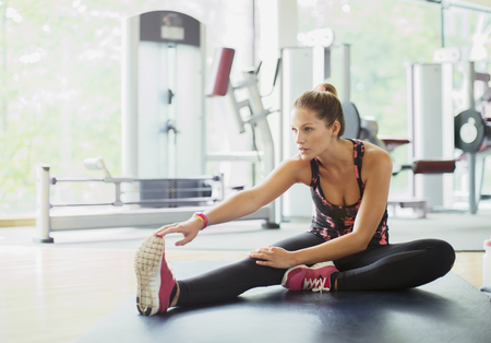 spandex: Woman stretching leg at gym LANG_EVOIMAGES